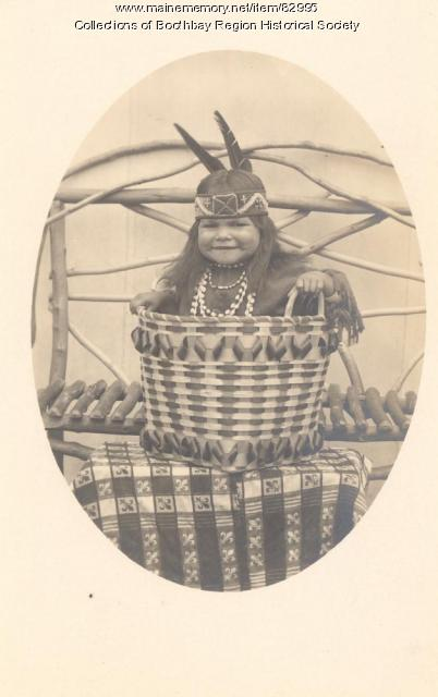 Indian child in basket, ca. 1915