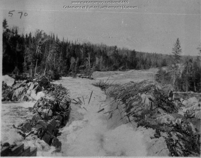 Logs running through a sluiceway, Maine woods
