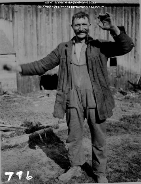 Man with cigar, Maine woods