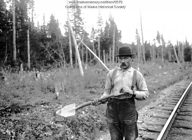 John Burton with weeding spade, ca. 1900