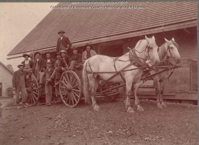 Taber wagon with horses and farm laborers, ca. 1910