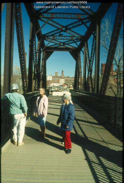 People on foot bridge, Lewiston and Auburn, ca. 1980