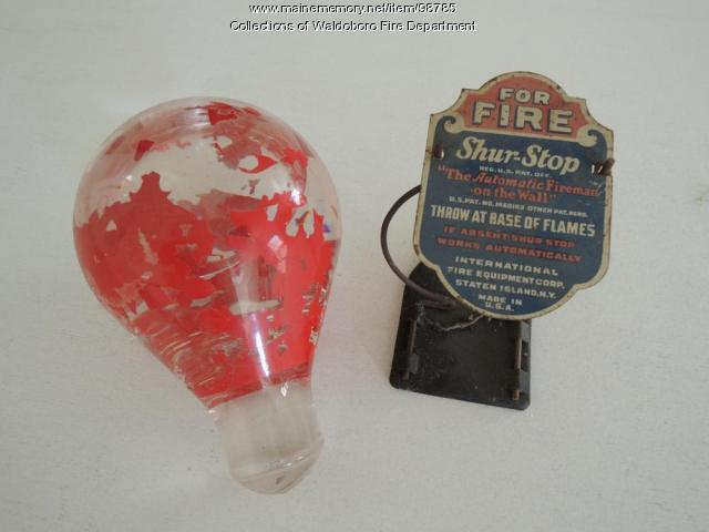 Red Comet fire extinguisher grenade with wall mount holder, Waldoboro, ca. 1900