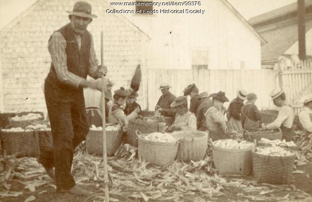 Shucking corn outside H.F. Webb Corn Shop, Leeds, ca. 1900